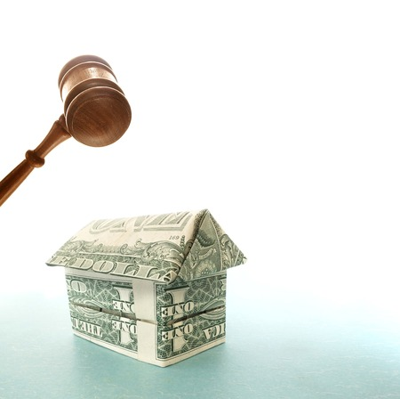 Origami house made out of dollar bills gavel                              photo