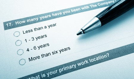company employee: Closeup of an employee opinion survey and pen