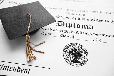 bachelor s degree: School diploma and mini graduation cap