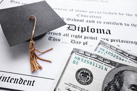School diploma and mini grad cap with cash                                Stock fotó