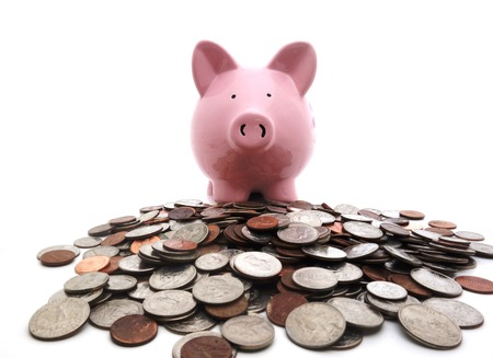 earn money: Piggy bank on a pile of coins