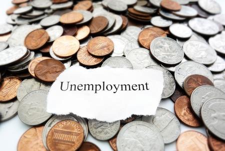 Newspaper headline with Unemployment text on coins