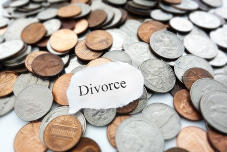 Divorce text on a pile of coins                                photo