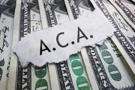 affordable: ACA - Affordable Care Act text on cash