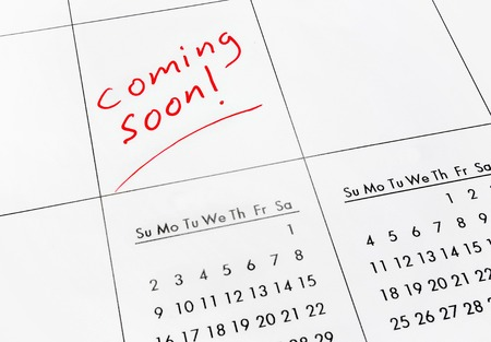 Coming Soon text in red on a calendar                                Stock Photo