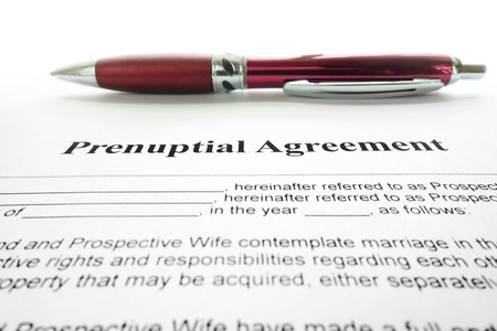 autograph: Prenup marriage agreement and pen