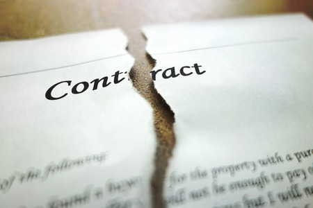 broken contract: Torn legal contract - legal concept