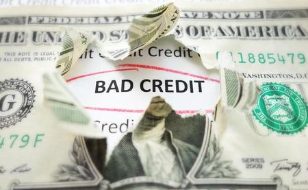 Bad Credit text under a torn dollar bill