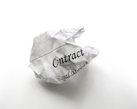 broken contract: Crumpled legal contract document - legal dispute concept