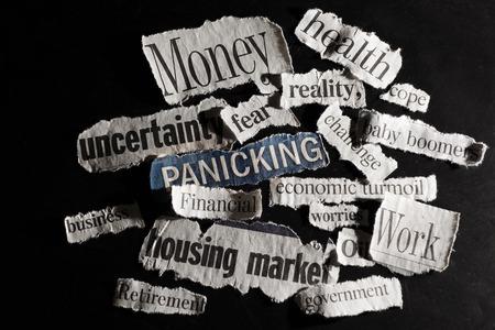 Torn paper economic news headlines  - economy  concept