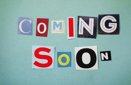 Coming Soon text spelled out in assorted paper letters                                Stock Photo