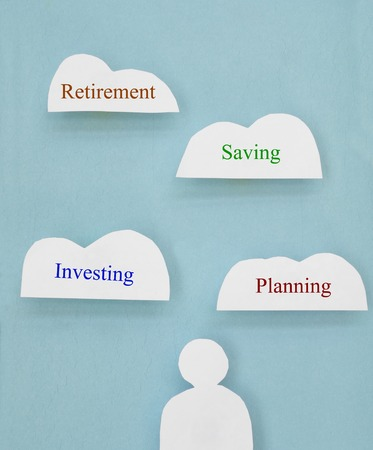 Paper cutout figure with financial related cloud text                                photo