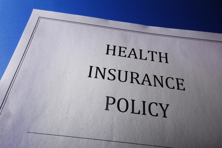 medical bills: Health care insurance policy, on blue                                Stock Photo