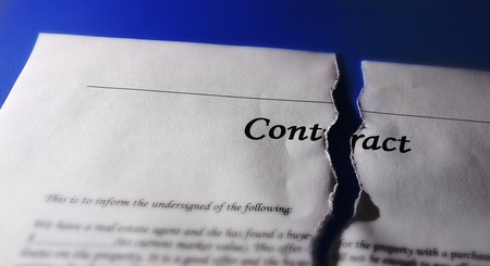 broken contract: Torn legal contract agreement, on blue