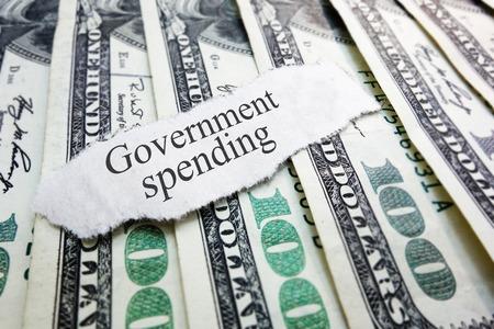 Government Spending newspaper headline on assorted money