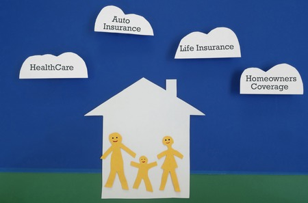 homeowners insurance: Family of three happy paper cutout figures with insurance themed clouds