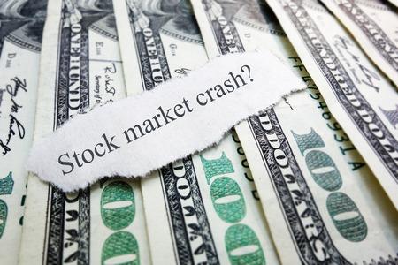 market crash: Stock Market Crash newspaper scrap on assorted money                                Stock Photo