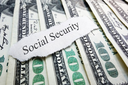 Social Security newspaper scrap on assorted money                                photo