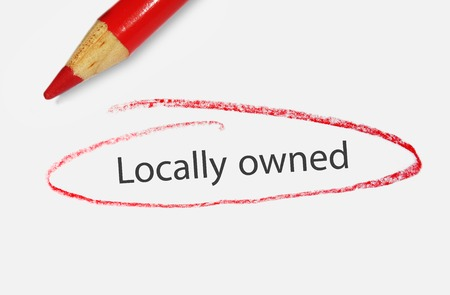 owned: Locally Owned text circled in red pencil - small business concept Stock Photo