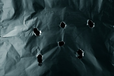 Bullet holes in metal textured background Stock Photo