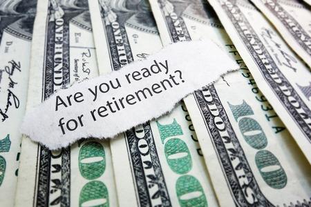 Retirement readiness newspaper headline on hundred dollar bills
