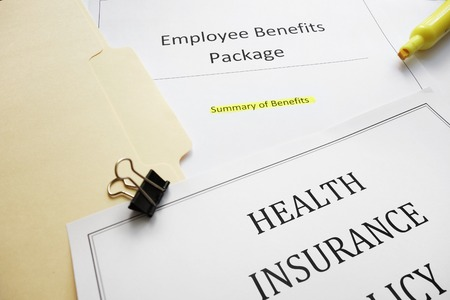 Employee Benefits package and health insurance document Foto de archivo