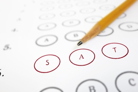 sat: Closeup of a SAT test answer sheet and pencil
