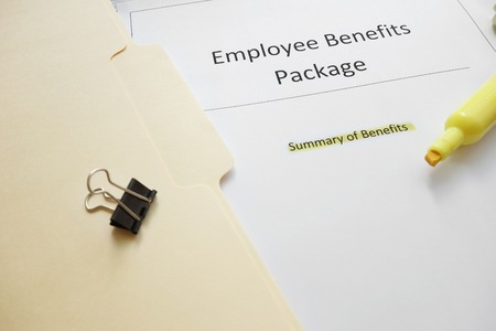 Employee benefits documents with highlighted text photo
