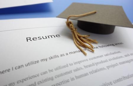 仕事応募履歴書・卒業キャップ 写真素材