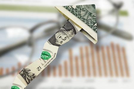 Dollar up arrow over a stock market chart