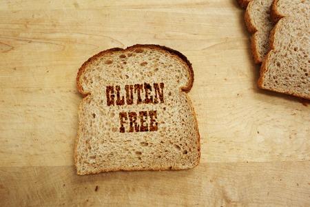 celiac disease: Bread slice with Gluten Free text Stock Photo