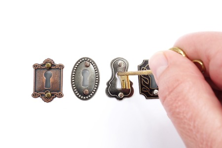 choose person: Assorted vintage locks with hand and key