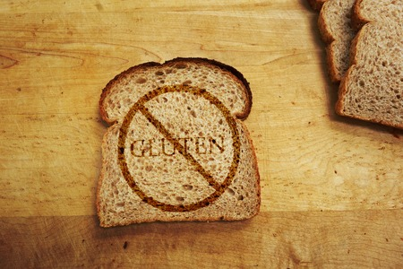 food allergy: Slice of bread with Gluten text - Gluten Free diet concept