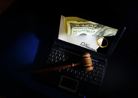 Judges court gavel on a laptop with Divorce concept on screen photo