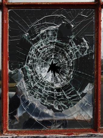 shattered glass: Shattered glass window pane with jagged hole Stock Photo