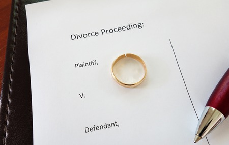 divorce court: Divorce document with broken ring and pen