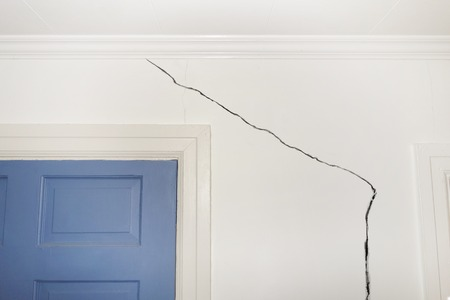 earthquake crack: Crack in the wall of a home