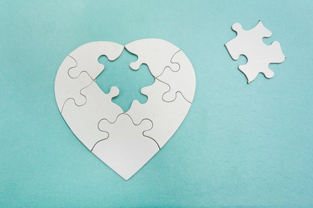 relationship breakup: Heart shaped puzzle with missing piece