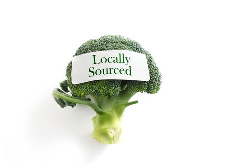 sourced: Fresh broccoli on white with Locally Sourced label