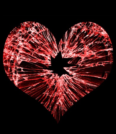 shattered: red heart shaped glass with a hole in the middle