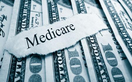medicare: Medicare paper headline on hundred dollar bills