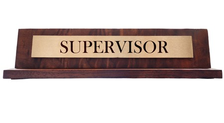 Wooden nameplate with Supervisor title, isolated on white