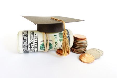 Mini graduation mortar board on cash and coins Standard-Bild