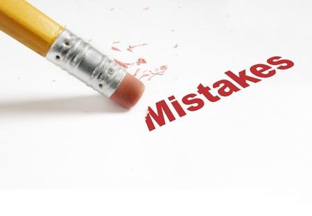pencil eraser: closeup of pencil eraser and red Mistakes text