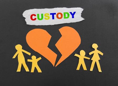 in custody: Paper family with broken heart and Custody text Stock Photo