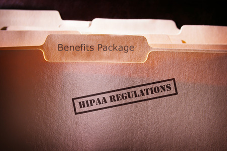file folders with HIPAA text and Benefits Package text