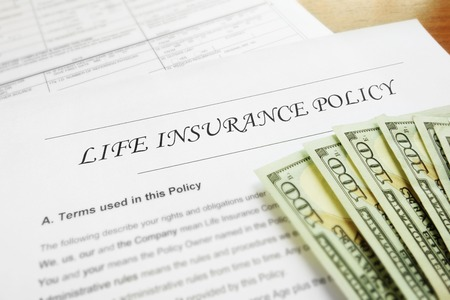 Life insurance policy and cash Stockfoto