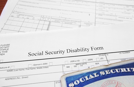 financial security: Social Security Disability form and Social Security card