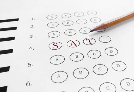 multiple choice: SAT text in red on a multiple choice test