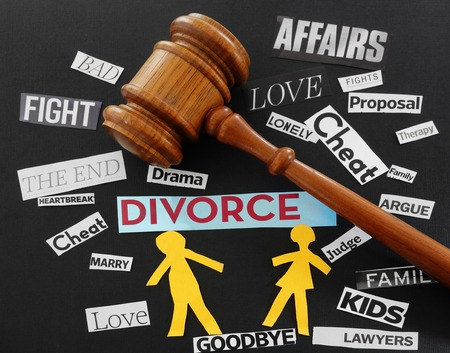 Paper couple with gavel and divorce related messages photo